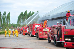 Group of firefighters man are inject spray the water to fire acc Royalty Free Stock Photography