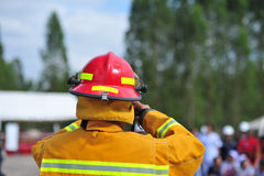 Group of firefighters man are inject spray the water to fire acc Stock Photos