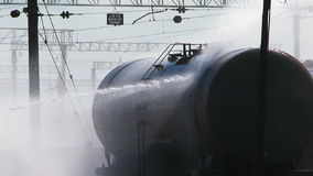 Group Of Firefighters Watering Tank At Railway stock footage
