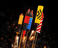 Group of fireworks rockets launching, on black background Stock Photos