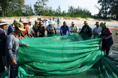 Group of fisherman pull fish net Royalty Free Stock Images