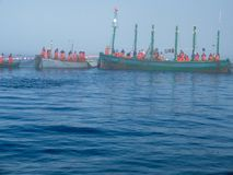 Group of fishermen encircling the trap with nets Bis Stock Images