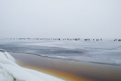 Group of fishermen fishing on the ice Stock Images