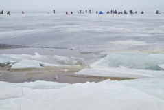 Group of fishermen fishing on the ice Stock Photography