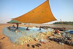 Group of fishermen knits their fishing net at Digha beach Royalty Free Stock Images