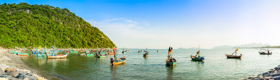 Group of fishing boat anchored at Pranburi beach in Thailand Stock Photos