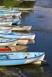 Group of fishing boats aligned with vertical composition. Near lake in Turkey Stock Photos