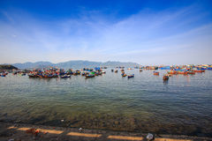 group of fishing boats transparent shallow water on foreground Stock Photography