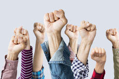 Group of fists raised in air. People group of fists raised in air royalty free stock image