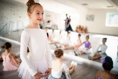 Group of fit happy children exercising ballet in studio together. Group of fit children exercising ballet in studio together stock images