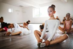 Group of fit happy children exercising ballet in studio together. Group of fit children exercising ballet in studio together stock image