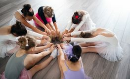 Group of fit happy children exercising ballet in studio together. Group of fit children exercising ballet in studio together stock photography
