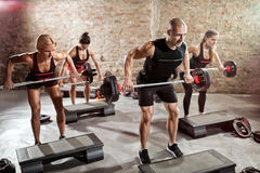 Group of fit people doing exercise with weights Stock Photos
