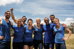 Group of fit people posing together in boot camp. On a sunny day stock image