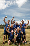 Group of fit people posing together in boot camp. On a sunny day Stock Photo