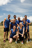 Group of fit people posing together in boot camp Stock Image