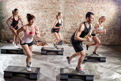 Group of fit people practicing on steeper stock photography