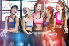 Group of fit woman smiling while sitting on exercise balls. In gym Stock Photos