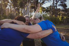 Group of fit women forming huddles in the boot camp Stock Photos