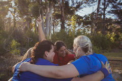 Group of fit women forming huddles in the boot camp Royalty Free Stock Image