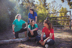 Group of fit women interacting with each other in the boot camp Stock Image