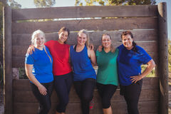 Group of fit women standing together in the boot camp. On a sunny day Stock Photo
