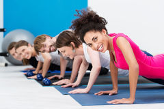 Group of fit young people doing push ups Stock Photography