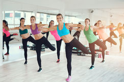 Group of fit young women working out in a gym Stock Photos