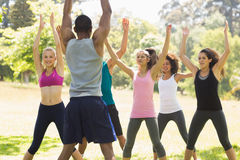 Group of fitness class exercising in park Royalty Free Stock Photos