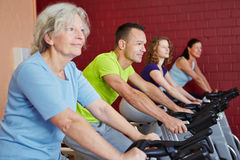 Group in fitness class in health. Group riding spinning bikes in a fitness class in health club Royalty Free Stock Photo