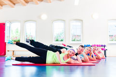 Group of fitness people in gym Stock Images