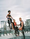 Fitness people relaxing after workout on rooftop stock photo