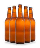 A group of five beer bottles in a diamond formation on white bac Stock Photography