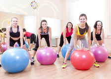 Group of Five Caucasian Female Athletes Having Exercises With Fitballs. Sport and Fitness Concepts and Ideas. Group of Five Caucasian Female Athletes Having Stock Photo