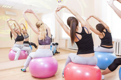 Group of Five Caucasian Female Athletes Having Stretching Exercises. Sport, Fitness, Wellness and Healthy Lifestyle Concepts. Group of Five Caucasian Female Stock Image