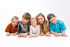 The group of five children on the foor Stock Photography
