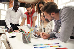 Group of five creative worker brainstorm together in office, new style of workspace, happy scene of people in office.  royalty free stock images