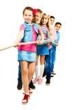 Kids pulling rope royalty free stock image
