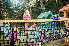 Group of five female school friends playing on the playground Stock Photo