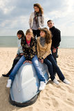 Group of five friends on the boat. Company of five teenagers on the board of a boat Royalty Free Stock Photos