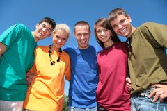 Group of five friends in multicolor  shirts Royalty Free Stock Photos
