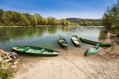Five boats on the river bank Royalty Free Stock Photo