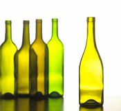 group of five green wine bottles Royalty Free Stock Photos
