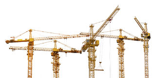 Group of five hoisting cranes on white Stock Photos