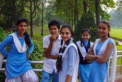 Indian student. Group of five smiling hopeful students in uniforms , New Delhi, 2013 Royalty Free Stock Photos