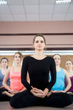 Group of five yogi females sitting in sukhasana Royalty Free Stock Image