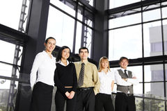 A group of five young businesspersons in an office Royalty Free Stock Photography