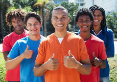 Group of five young men showing thumbs up Stock Photography