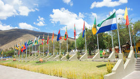 Group of flags of the 24 provinces of the Republic of Ecuador in the Ciudad Mitad del Mundo turistic center near of Quito city Royalty Free Stock Image