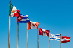Flags on Poles From Various Countries Royalty Free Stock Images